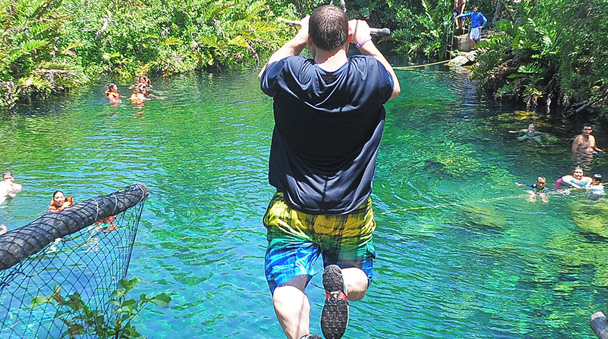 Let your ATV takes you till the cenotes to jump and swim into them