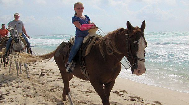 Riding your horse in the beach
