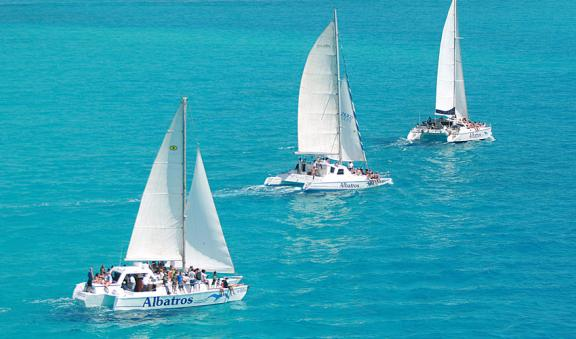 sailing above turquoise blue water