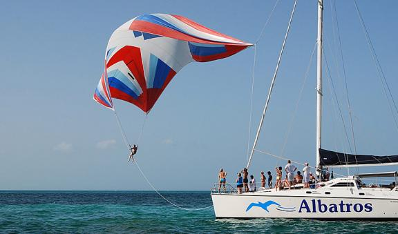 Parasailing above turquoise blue waters